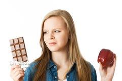 苹果计算机或巧克力 免版税库存照片