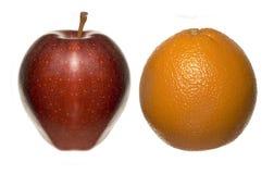 苹果计算机桔子 图库摄影