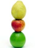 苹果计算机番石榴和桔子 库存照片