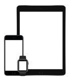 苹果计算机空间灰色iPad赞成iPhone 6S和苹果计算机观看垂直 免版税库存图片