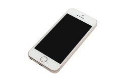 苹果计算机金子iPhone 5S 免版税库存图片