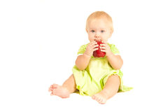 苹果婴孩吃红色 库存照片