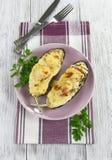 茄子烘烤与菜和乳酪 免版税库存照片