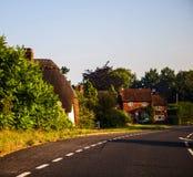 茅屋顶和老房子 免版税图库摄影