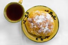 茶和小圆面包 免版税库存图片