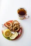 茶和甜点杯子 免版税库存照片