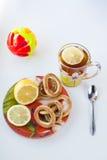 茶和甜点杯子 免版税库存图片