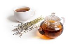 茶壶和淡紫色在白色桌上 免版税库存图片