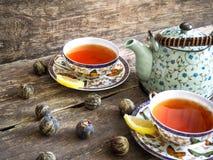 茶壶红茶绿茶老板 免版税库存照片