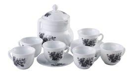 茶罐集合,瓷茶罐和杯子在白色背景 免版税库存图片