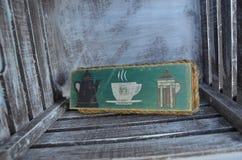 茶袋或咖啡的箱子在一个土气样式 免版税库存图片