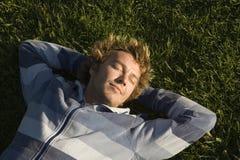 草坪位于的人 图库摄影