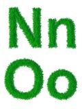 绿草字母表 免版税库存图片