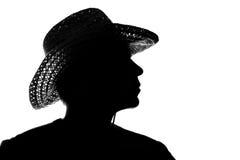 草帽的年轻人-剪影 免版税库存图片