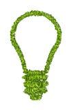 从绿草的生态电灯泡象 免版税库存照片