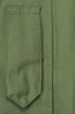 草绿色绿色ECWCS附头巾皮外衣等级权威徽章圈特写镜头,空白的空的垂直的服装背景拷贝空间,前面Placket 免版税库存照片