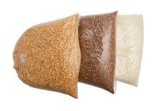 荞麦、米和豌豆在一个塑料袋 免版税库存照片