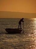 荡桨在日落2 库存照片