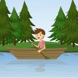 荡桨在河的男孩一条小船 图库摄影