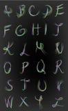 荧光的五颜六色的字母表 免版税库存图片