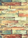 荧光的五颜六色的砖墙背景垂直的框架  库存图片