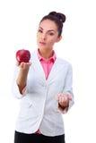 药房 药片或苹果,维生素的两个来源 库存图片