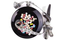 药片和测量的磁带 库存照片