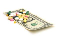 """药片和金钱†""""便宜的药物概念 免版税库存图片"""