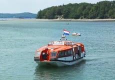 荷兰美国游轮Maasdam招标小船 图库摄影