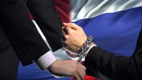 荷兰认可俄罗斯,被束缚的胳膊,政治或者经济冲突 股票视频