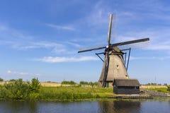 荷兰风车和一点流洒了 库存图片