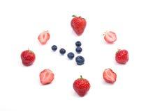 莓果手表差不多十二时 免版税库存图片
