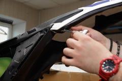 莫托服务大师与摩托车一起使用的塑料元素 免版税库存图片