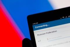 莫斯科,俄罗斯- 2018年4月17日:一个手机在有电报应用`连接`的手上 俄罗斯旗子颜色 免版税图库摄影