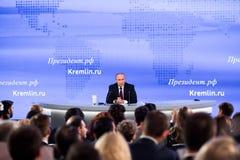 莫斯科,俄罗斯- DEC 23 :俄罗斯联邦弗拉基米尔弗拉基米洛维奇普京的总统一次每年新闻招待会在中心 免版税库存照片