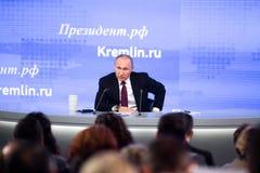 莫斯科,俄罗斯- DEC 23 :俄罗斯联邦弗拉基米尔弗拉基米洛维奇普京的总统一次每年新闻招待会在中心 免版税图库摄影