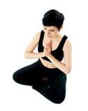 莲花坐实践的女子瑜伽年轻人 免版税库存图片