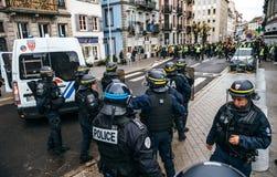 获取区域的Strasburg警察在抗议期间 免版税库存图片
