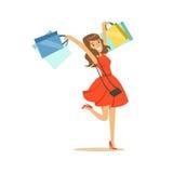 获得一件典雅的红色的礼服的年轻愉快的妇女与购物袋五颜六色的字符传染媒介例证的乐趣 免版税库存照片