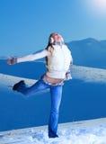 获得乐趣在冬天山 库存图片