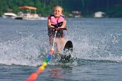 获得女孩滑雪障碍滑雪  免版税库存照片