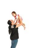 获得的母亲与小孩女儿的乐趣 免版税库存图片