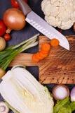 菜和种子在木板 免版税库存图片