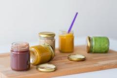 菜或果子纯汁浓汤或者婴儿食品在瓶子 图库摄影
