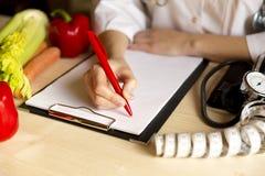 菜饮食营养和疗程概念 营养师  库存图片