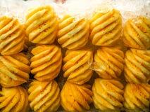 菠萝许多球在背景白色 库存图片