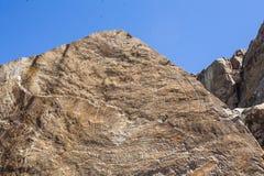 菩萨在Tamgaly Tas的一个岩石-联合国科教文组织世界遗产名录站点雕刻了在哈萨克斯坦 免版税图库摄影
