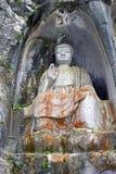 菩萨岩石雕刻在灵隐寺,中国 库存照片