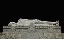 菩萨斜倚的雕象 库存图片