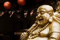 菩萨笑的雕象 免版税库存照片